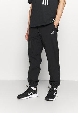 CITY - Spodnie treningowe - black
