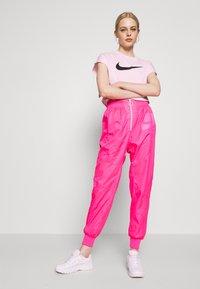 Nike Sportswear - Tracksuit bottoms - hyper pink/pinksicle/white - 1