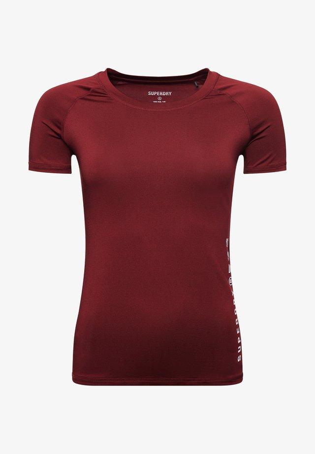 TRAINING ESSENTIAL - Basic T-shirt - claret