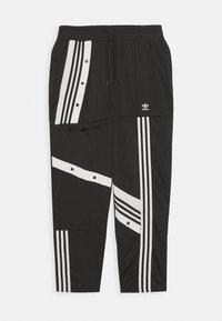CATHARI - Teplákové kalhoty - black