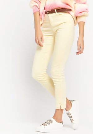 WITH BELT - Jeans slim fit - yellow