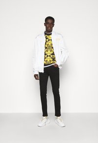 Versace Jeans Couture - AMETIST  - Slim fit jeans - black - 1