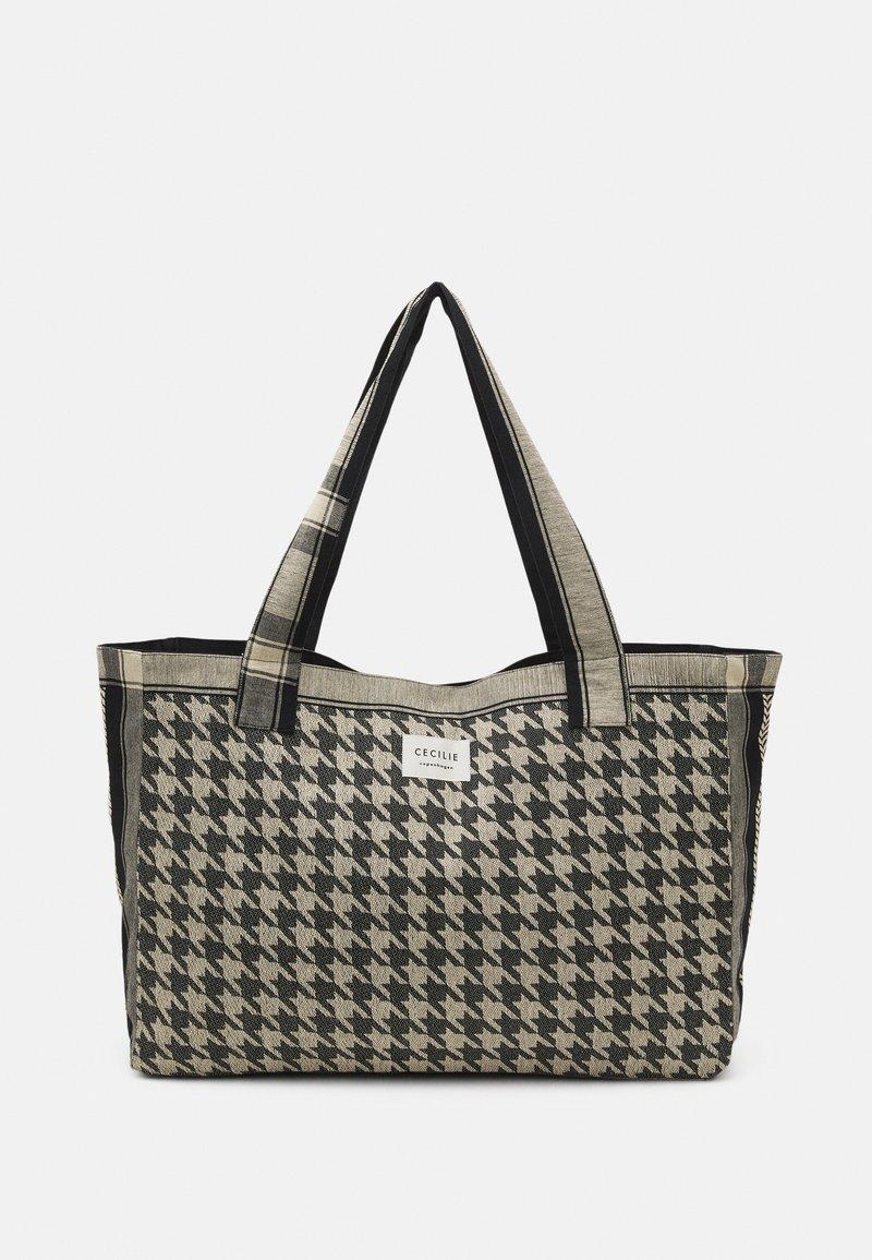 CECILIE copenhagen - BAG LARGE DOGTOOTH - Shopping bag - black/cream