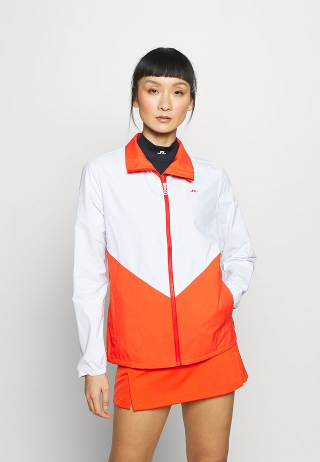 LILYTH - Training jacket - tomato red