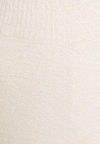 NA-KD - NA-KD X ZALANDO EXCLUSIVE - FLUFFY PANTS - Spodnie materiałowe - white - 2