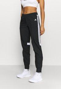 adidas Performance - TRACK PANT - Joggebukse - black/halo silver/white - 0