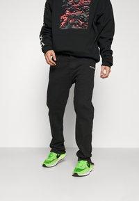 Pegador - BAYAMO DISTRESSED ANKLE - Straight leg jeans - black - 0
