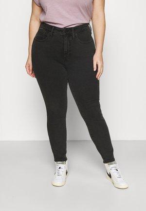 SKINNY FLARE - Jeans Skinny Fit - black denim