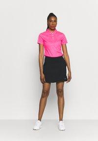 Nike Golf - VICTORY SOLID SKIRT - Sports skirt - black/dust - 1