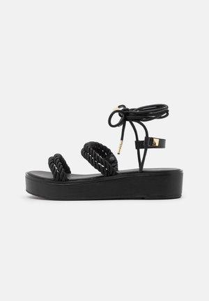 MARINA - Sandály na platformě - black