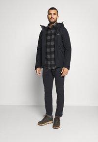 Haglöfs - SKUTA JACKET MEN - Hardshell jacket - true black - 1