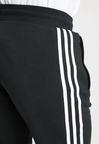 adidas Originals - STRIPES PANT UNISEX - Pantaloni sportivi - black - 4