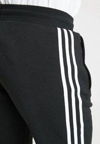 adidas Originals - STRIPES PANT UNISEX - Pantalon de survêtement - black - 4