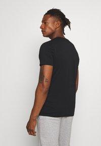 Peak Performance Urban - URBAN TEE - Basic T-shirt - black - 2