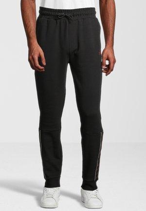 OMER - Teplákové kalhoty - black