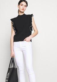 KARL LAGERFELD - COLORBLOCK RUFFLE CROP - Print T-shirt - black - 5