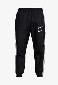 Nike Sportswear - Träningsbyxor - black/particle grey/white - 4