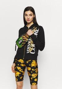 Versace Jeans Couture - JUNGLE PRINT BELT BAG - Bum bag - multicoloured - 1