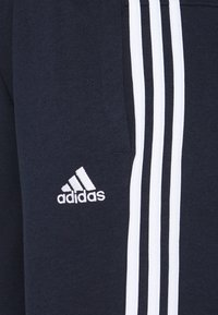 adidas Performance - ESSENTIALS FRENCH TERRY STRIPES PANTS - Tracksuit bottoms - legend ink/white - 5