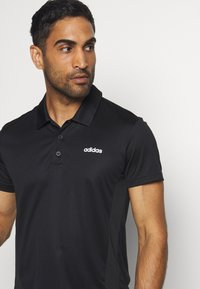 adidas Performance - TRAINING SPORTS SHORT SLEEVE  - Sports shirt - black/white - 4