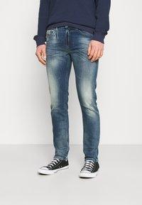 Diesel - THOMMER-X - Slim fit jeans - medium blue - 0