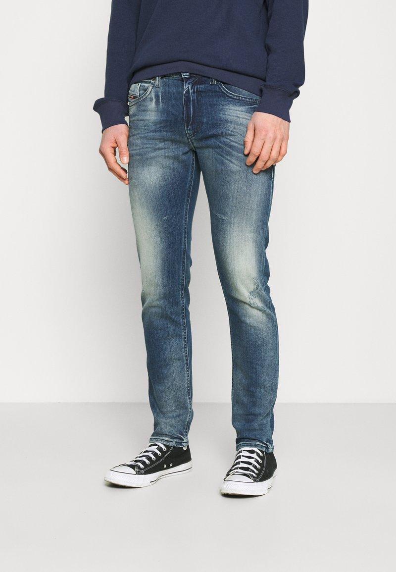 Diesel - THOMMER-X - Slim fit jeans - medium blue