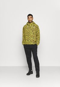 The North Face - PRINTED CLASS FANORAK - Outdoor jacket - mustard yellow/dark blue - 1