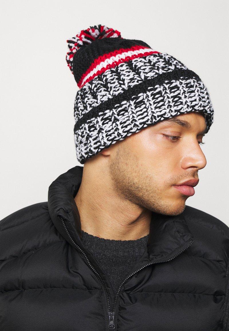 Eisbär - FLOG POMPON - Mütze - schwarz/weiß/bunt