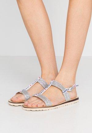 Sandaalit nilkkaremmillä - argento