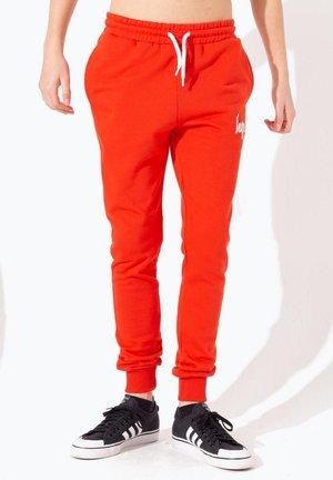 Pantalon de survêtement - red