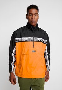 adidas Originals - REVEAL YOUR VOICE - Windbreakers - flash orange - 0
