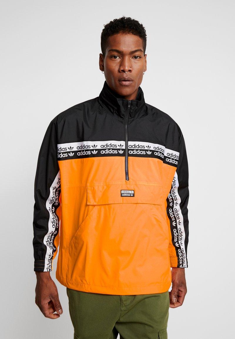 prova Sfondo verde Anziani  adidas Originals REVEAL YOUR VOICE - Giacca a vento - flash orange - Zalando .it