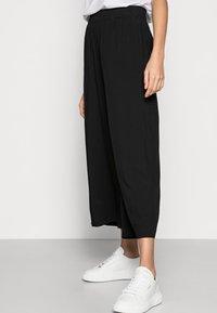 Esprit - FLOATY PANTS - Trousers - black - 3