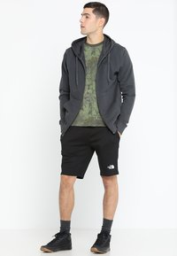 The North Face - MENS GRAPHIC SHORT  - Sports shorts - black - 1