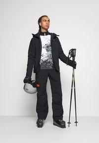 Helly Hansen - SOGN - Spodnie narciarskie - black - 1