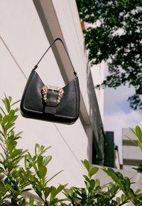 Versace Jeans Couture - BUCKLE SHOULDER BAG - Handbag - nero - 5