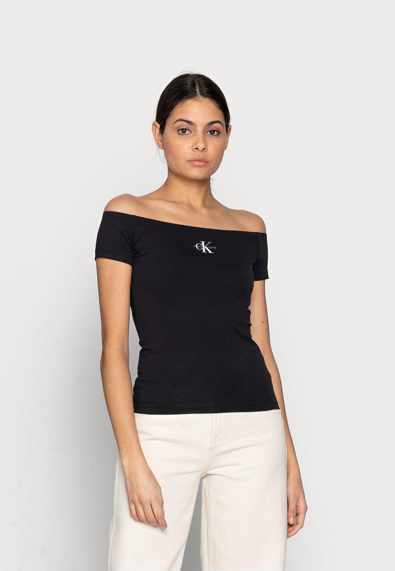 Calvin Klein Jeans - MONOGRAM SLIM BARDOT TOP - Print T-shirt - black