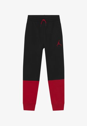 JUMPMAN AIR - Tracksuit bottoms - black/gym red