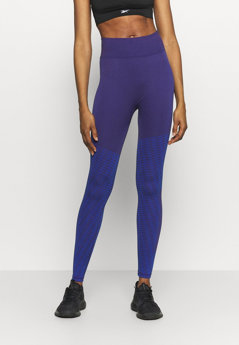 Reebok - SEASONAL SEAMLESS - Leggings - purple