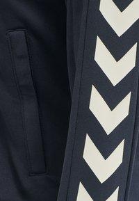 Hummel - HMLRAMONA  - Training jacket - blue nights - 5