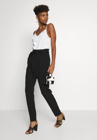 JDY - JDYTANJA  - Trousers - black - 1