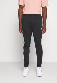 adidas Originals - UNISEX - Pantalon de survêtement - black/white - 0
