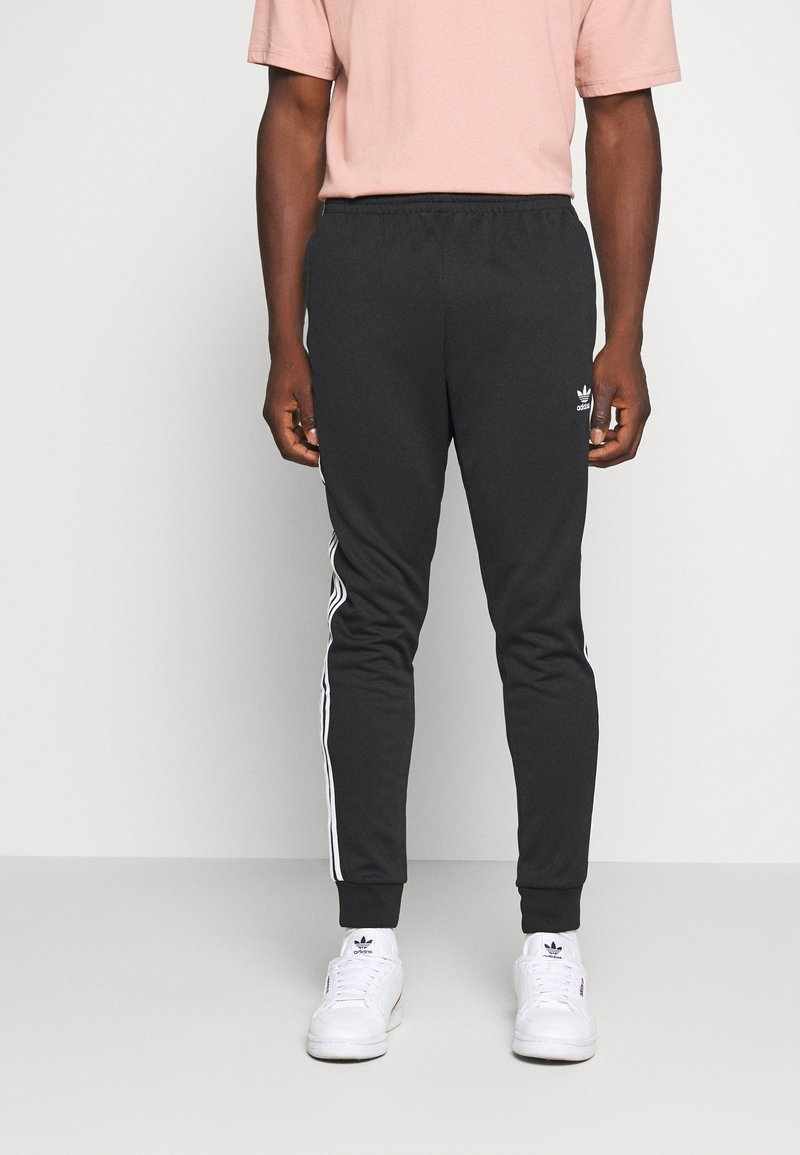 adidas Originals - UNISEX - Pantalon de survêtement - black/white