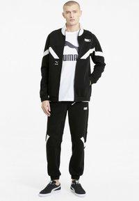 Puma - INTERNATIONAL  - Training jacket - puma black - 1