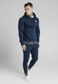 SIKSILK - MUSCLE FIT TAPE CUFF JOGGER - Tracksuit bottoms - navy - 1