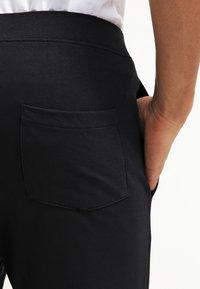 YOURTURN - Pantalones deportivos - black - 6