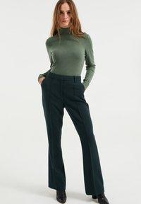 WE Fashion - Trousers - moss green - 0