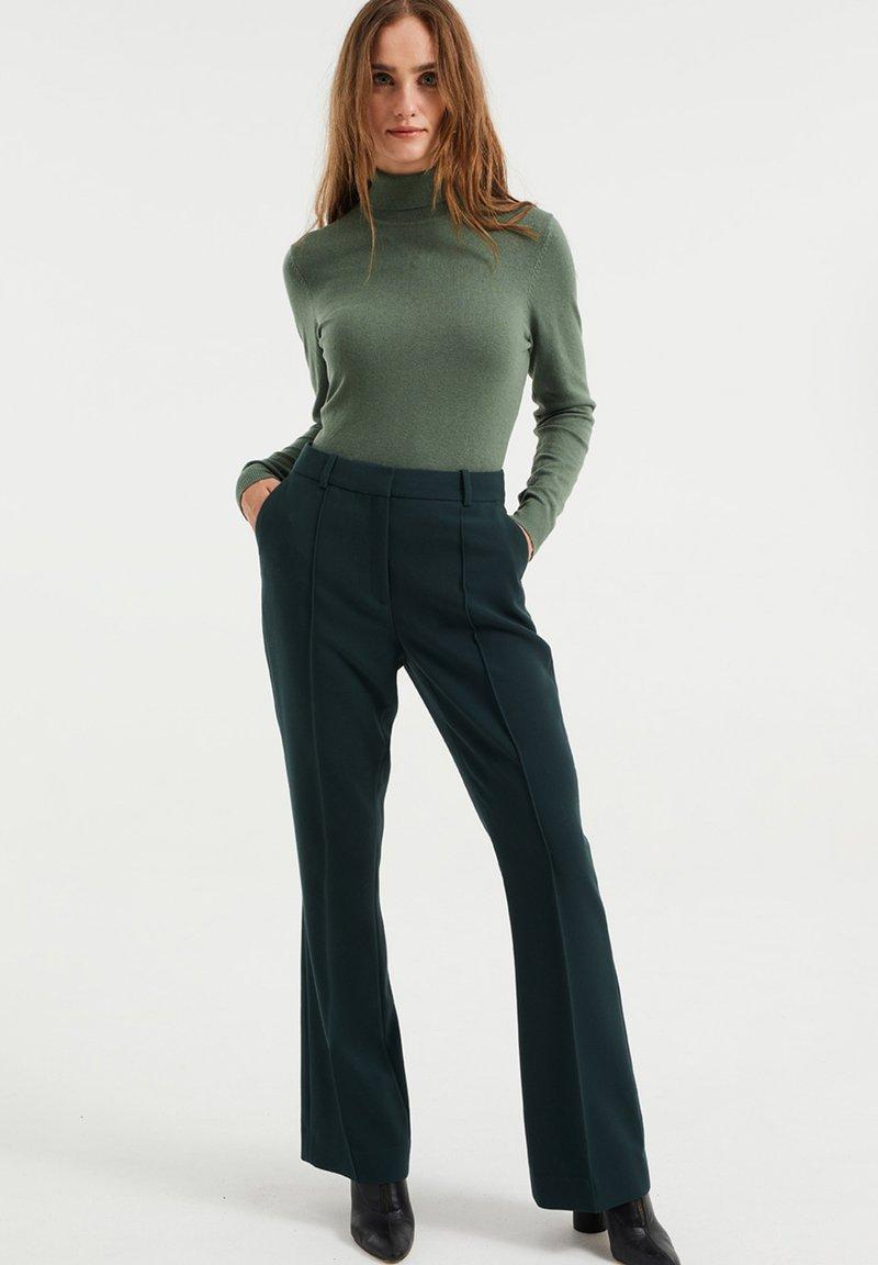 WE Fashion - Trousers - moss green