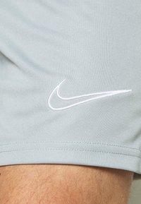 Nike Performance - SHORT - Sports shorts - light pumice/white - 5