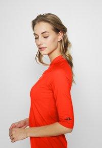 J.LINDEBERG - SAHRA LUX SCULPT - Sportovní šaty - tomato red - 3